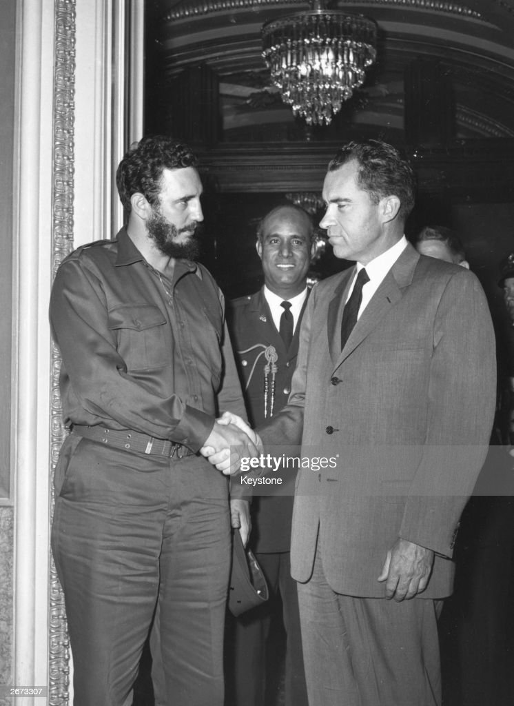 Cuban President Fidel Castro shaking hands with American vice-president Richard Nixon during a press reception in Washington.