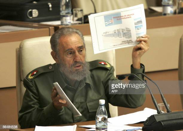 Cuban President Fidel Castro shows a document during the plenary session of the Cuban Parliament 23 December, 2005 in Havana. Castro on Friday called...