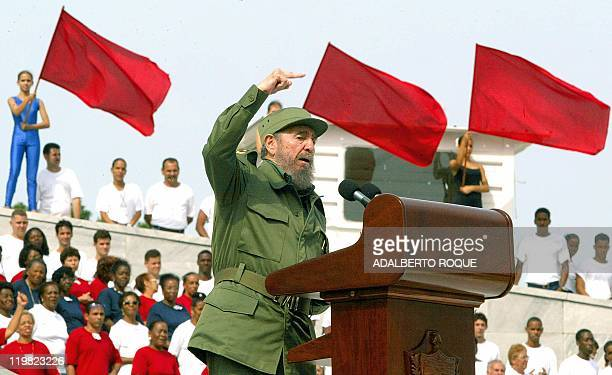 Cuban President Fidel Castro speaks 01 May 2003 to a crowd of hundreds of thousands of people waving flags and shouting slogans in central Havana 01...