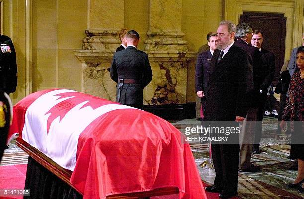 Cuban President Fidel Castro stands in front of the casket of former Canadian prime minister Pierre Trudeau at the Montreal City Hall building in...