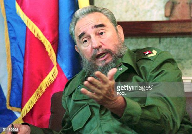 Cuban President Fidel Castro talks 10 August 1993 during an interview with Colombian President Cesar Gaviria at the presidential residence in the...