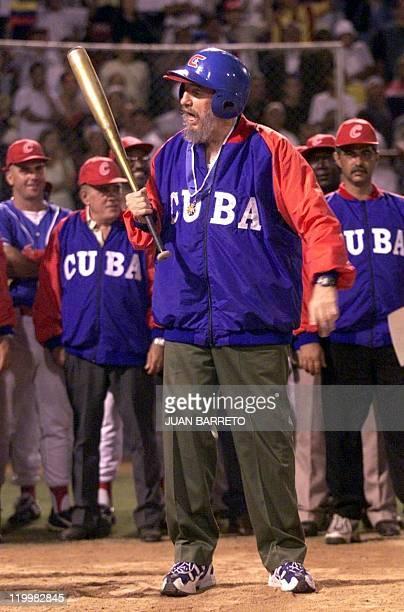 Cuban President Fidel Castro talks to the umpire during a baseball game against the Venezuelan team, led by Venezuelan counterpart Hugo Chavez, in...