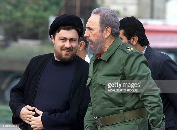 Cuban President Fidel Castro walks with Hojjatoleslam Hajj Seyed Hassan Khomeini grandson of late Iranian revolutionary leader Ayatollah Ruhollah...