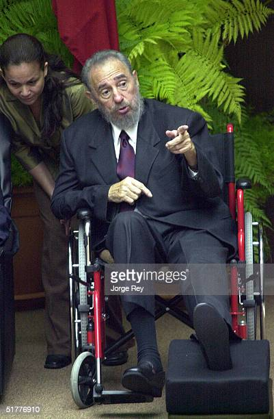 Cuban President Fidel Castro who is recovering from injuries suffered in a fall attends a meeting with Chinese President Hu Jintao at the Palace of...