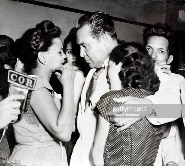 Cuban president Fulgencio Batista offering words of comfort and encouragement to women whose husbands had been killed in the July rising before...