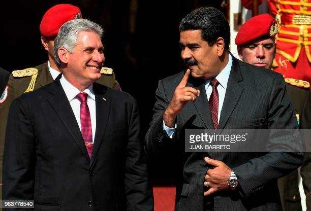 Cuban President Miguel DiazCanel and his Venezuelan counterpart Nicolas Maduro chat during a meeting at Miraflores presidential palace in Caracas on...