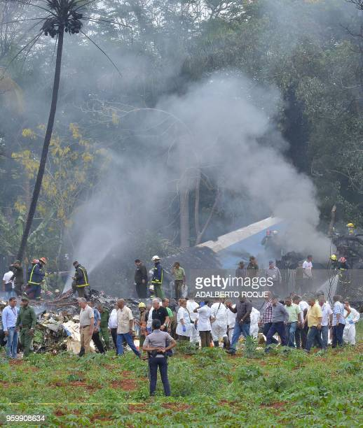 Cuban President Miguel DiazCanel is pictured at the site of the accident after a Cubana de Aviacion aircraft crashed after taking off from Havana's...