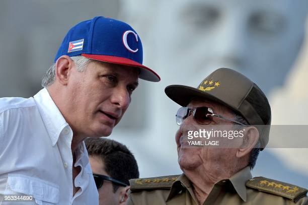 Cuban President Miguel DiazCanel listens to former president Raul Castro during the May Day rally at Revolution Square in Havana on May 1 2018