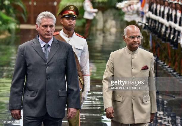 Cuban President Miguel DiazCanel walks nex to Indian President Ram Nath Kovind during his welcome ceremony at the Revolution Palace in Havana on June...