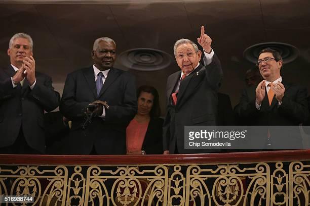 Cuban President Raul Castro acknowledges applause while joining Cuban Vice President Miguel DíazCanel Cuban Parliamentarian Esteban Lazo Hernandez...