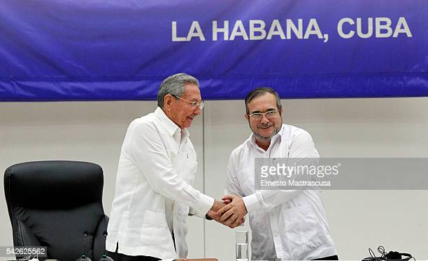 Cuban President Raul Castro and FARC's leader Timoleon Jimenez 'Timonchenko'shake hands during a ceremony to sign a historic ceasefire agreement...