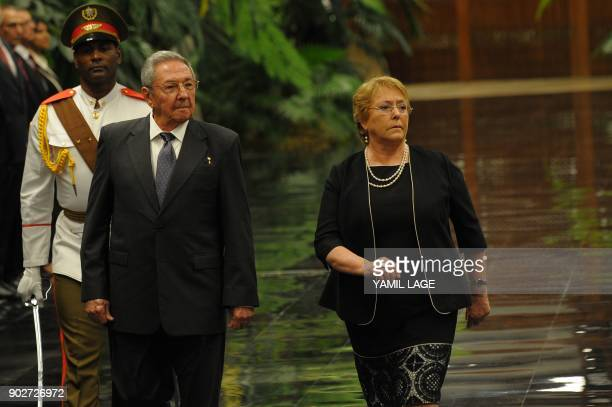 Cuban President Raul Castro and his Chilean counterpart Michelle Bachelet review the honour guard at the Revolution Palace in Havana on January 8...