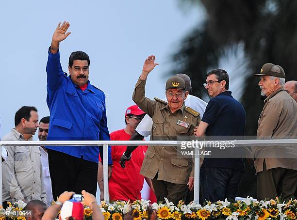 Cuban President Raul Castro and his Venezuelan counterpart Nicolas Maduro participate in the May Day celebrations on May 1 2015 in Havana AFP...