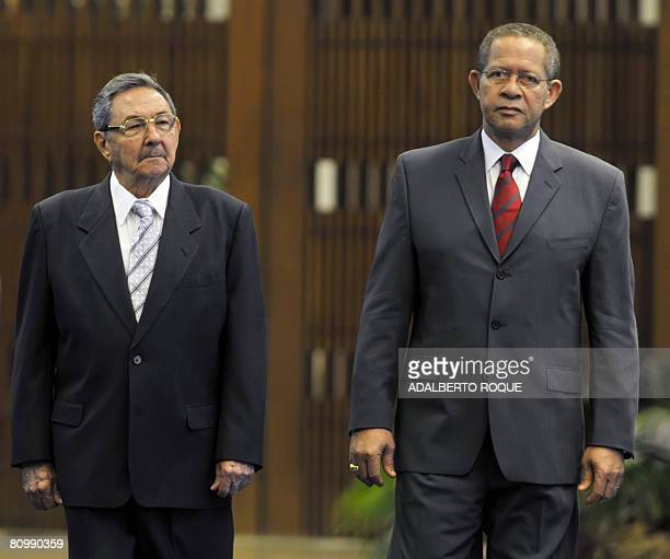 Cuban President Raul Castro and Jamaican Prime Minister Orette Bruce Golding stand together during the welcoming ceremony at Revolution Palace in...