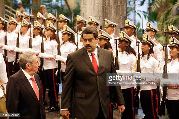 Cuban President Raul Castro and President Nicolas Maduro of Venzuela walk past the Guard of Honor at the Cuban State Council during an official...