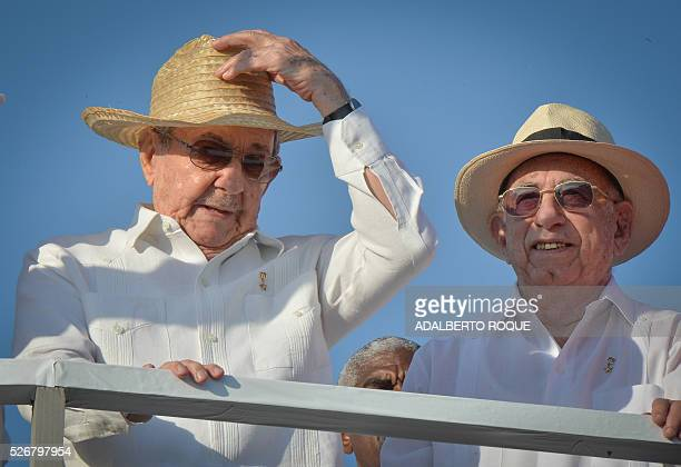 Cuban President Raul Castro and VicePresident Jose Ramon Machado Ventura attend the May Day parade at Revolution Square in Havana on May 1 2016 / AFP...