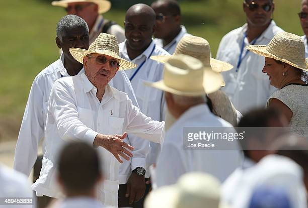 Cuban President Raul Castro greets people after attending the Plaza de la Revolution Mass given by Pope Francis on September 21 2015 in Holguin Cuba...