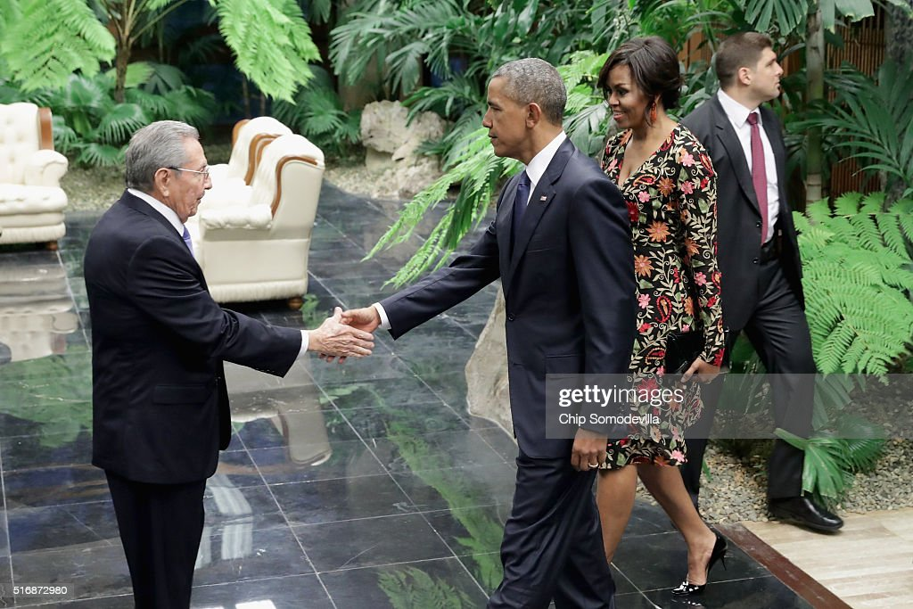Cuban President Raul Castro (L) greets U.S. President Barack Obama (C) and first lady Michelle Obama (R) before a state dinner at the Palace of the Revolution March 21, 2016 in Havana, Cuba. March 21, 2016 in Havana, Cuba. This is the first time a sitting U.S. president has visited Cuba in 88 years.