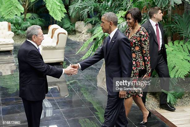 Cuban President Raul Castro greets US President Barack Obama and first lady Michelle Obama before a state dinner at the Palace of the Revolution...