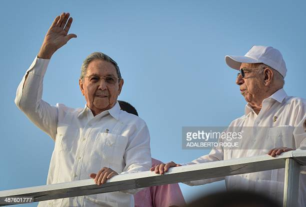 Cuban President Raul Castro next to Vicepresident Jose Ramon Machado Ventura waves during the May Day parade organized by the Cuban Workers Union in...