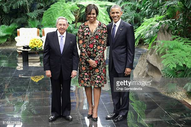 Cuban President Raul Castro poses for a photograph with US first lady Michelle Obama and US President Barack Obama before a state dinner at the...