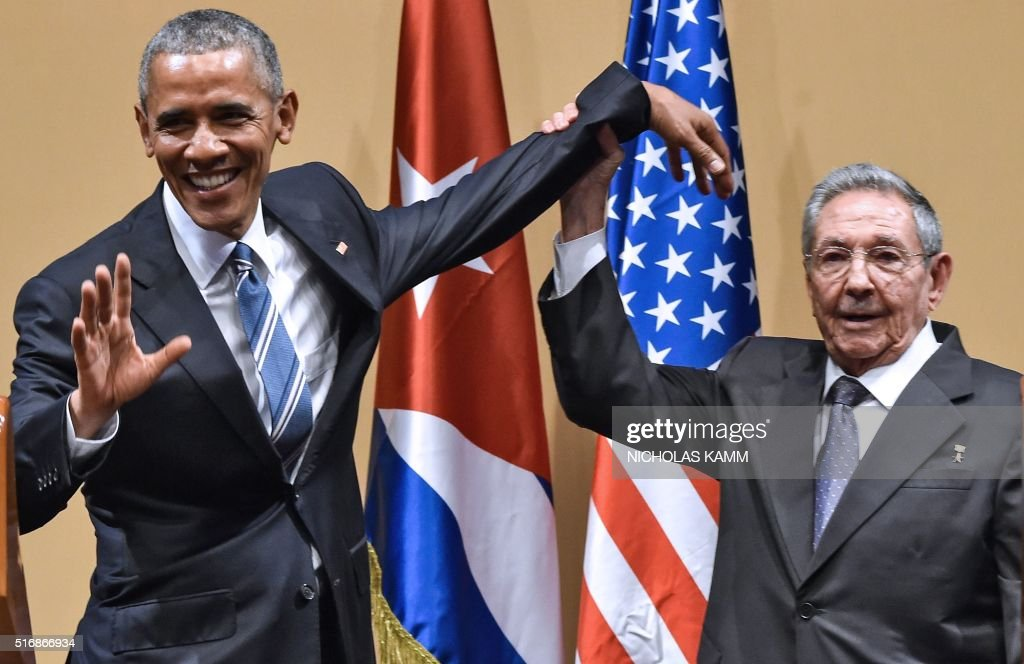 TOPSHOT - Cuban President Raul Castro (R) raises US President Barack Obama's hand during a meeting at the Revolution Palace in Havana on March 21, 2016. Cuba's Communist President Raul Castro on Monday stood next to Barack Obama and hailed his opposition to a long-standing economic 'blockade,' but said it would need to end before ties are fully normalized. AFP PHOTO/Nicholas KAMM / AFP / NICHOLAS