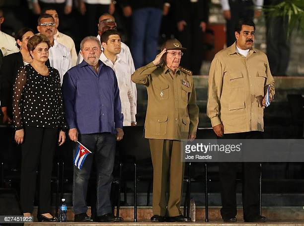 Cuban President Raul Castro salutes during the Cuban National Anthem as he stands with Brazilian impeached former president Dilma Rousseff former...