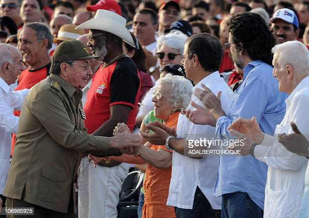 Cuban President Raul Castro shakes hand with elderly revolutionaries as his arrives at Che Guevara Revolution Square in the legendary city of Santa...