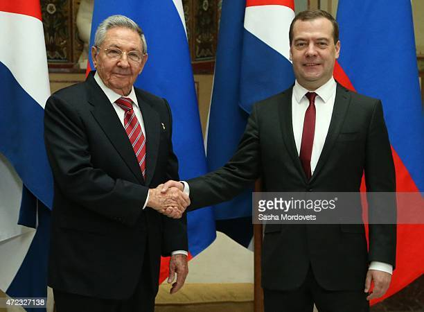 Cuban President Raul Castro shakes hands with Russian Prime Minister Dmitry Medvedev during their meeting on May 6 2015 in Moscow Russia Castro is...