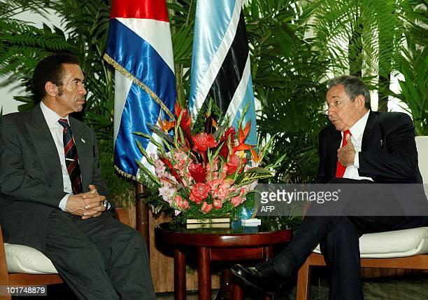Cuban President Raul Castro speaks with Botswana's President Seretse Khama Ian Khama during the welcoming ceremony on June 7 2010 at the Revolution...