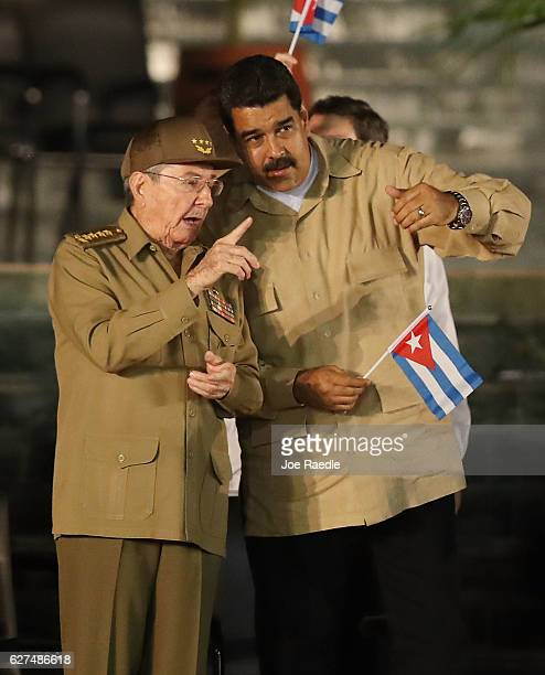 Cuban President Raul Castro speaks with Venezuela's President Nicolas Maduro during a memorial tribute for his brother former President of Cuba Fidel...