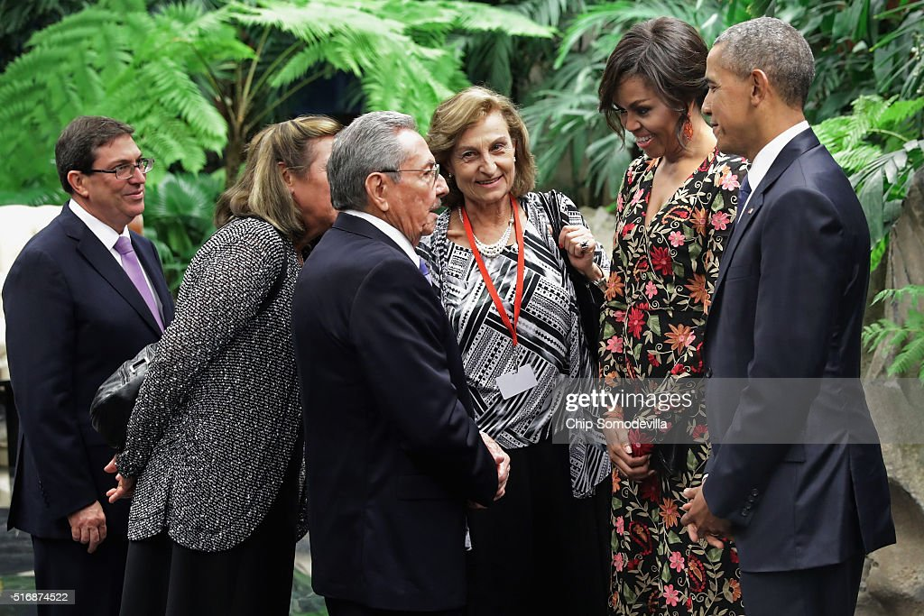 Cuban President Raul Castro (3rd L), U.S. first lady Michelle Obama and U.S. President Barack Obama (R) greet one another with the help of translators before a state dinner at the Palace of the Revolution March 21, 2016 in Havana, Cuba. March 21, 2016 in Havana, Cuba. This is the first time a sitting U.S. president has visited Cuba in 88 years.