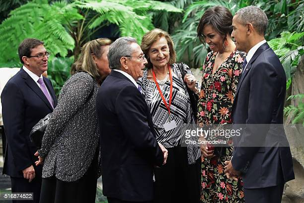 Cuban President Raul Castro US first lady Michelle Obama and US President Barack Obama greet one another with the help of translators before a state...