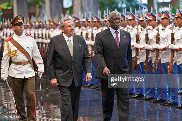 Cuban President Raul Castro walks with Sao Tome and Principe President Manuel Pinto da Costa on June 17 2013 at Revolution Palace in Havana AFP...