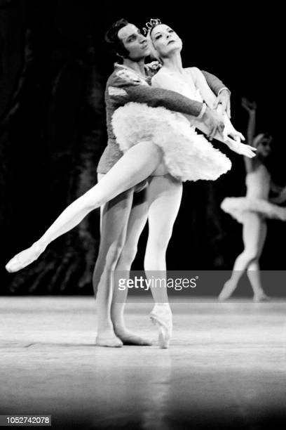 Cuban prima ballerina assoluta Alicia Alonso and Russian Azari Plisetski perform 'Swan Lake' at the Chmap Elysées theater Paris on December 1 1970