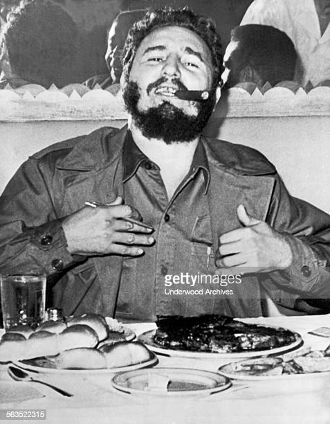 Cuban Prime Minister Fidel Castro enjoys a steak dinner while holding an impromptu press conference at the Theresa Hotel in Harlem during his visit...