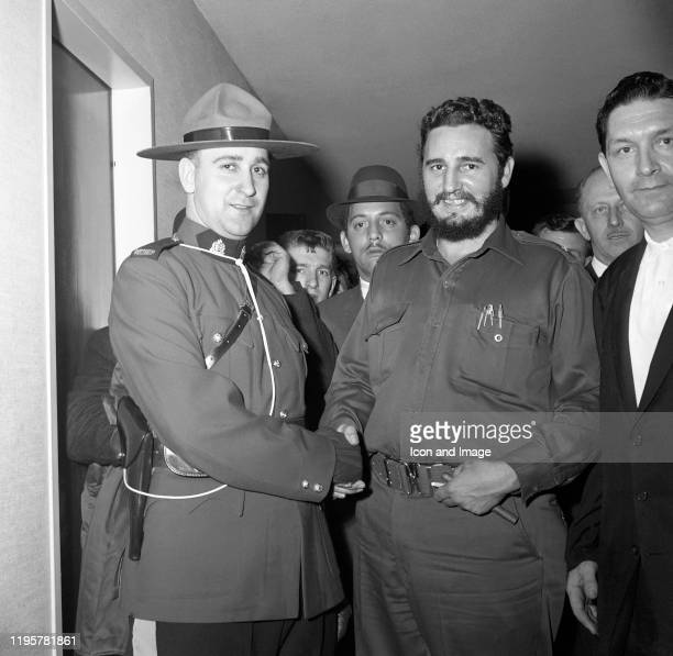 Cuban Prime Minister Fidel Castro is escorted by the Royal Canadian Mounted Police as they pose for a portrait during his stay at the Queen Elizabeth...