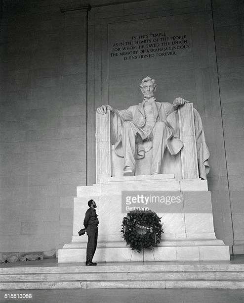 Cuban Prime Minister Fidel Castro looks up at a statue of emancipator Abraham Lincoln after laying a wreath at the Lincoln Memorial