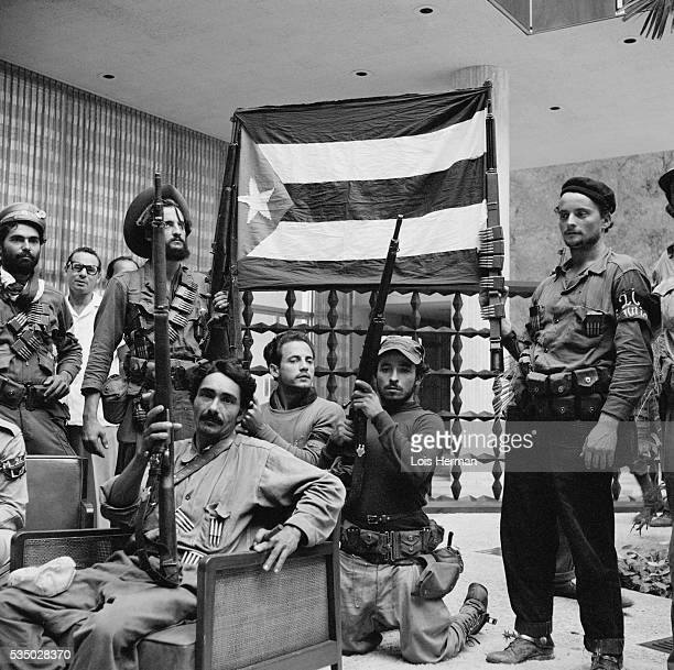 1/59 Cuban rebel soldiers holding up flag Hilton Hotel lobby Havana Cuba