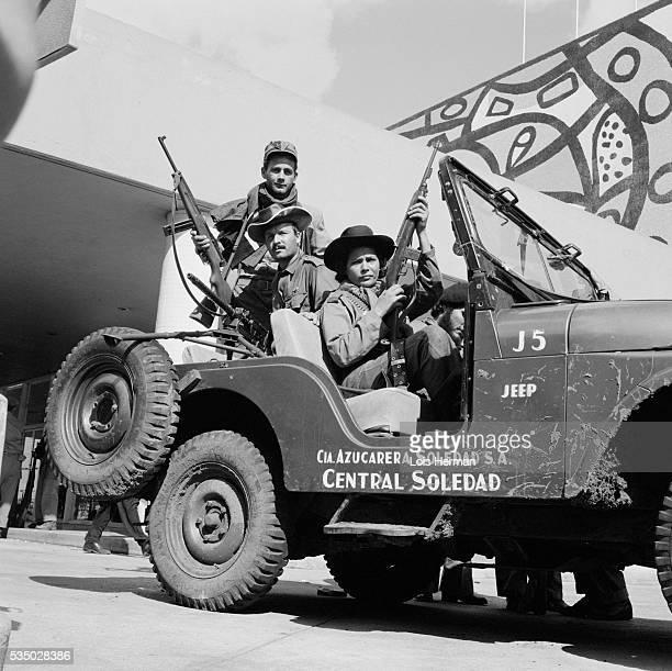 1/59 Cuban rebel soldiers in jeep in front of Hilton Hotel Havana Cuba