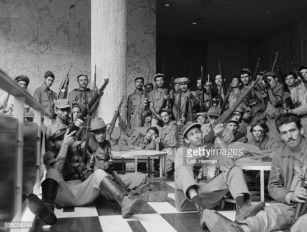 Cuban rebel soldiers in the lobby of the Hilton Hotel Havana Cuba 1/59