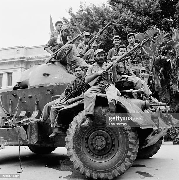 1/59 Cuban rebel soldiers posing with guns on tank Havana Cuba