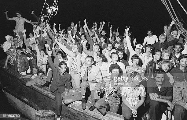 Cuban refugees wait for US Immigration aboard the shrimp boat Big Babe at Key West Florida early after arriving from Cuba