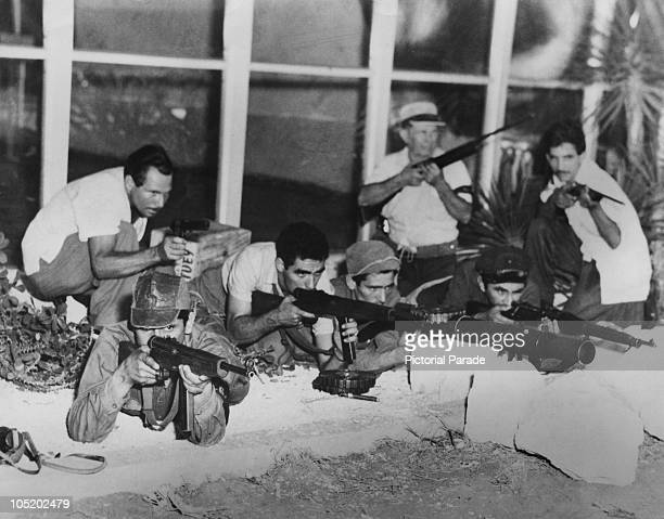 Cuban revolutionaries attacking a Nationalist army post at Camajuani during the Battle of Santa Clara Cuba December 1958 The battle ended in the...