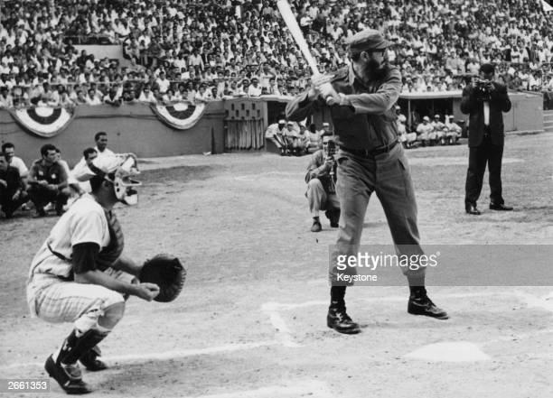Cuban revolutionary leader Fidel Castro playing baseball.