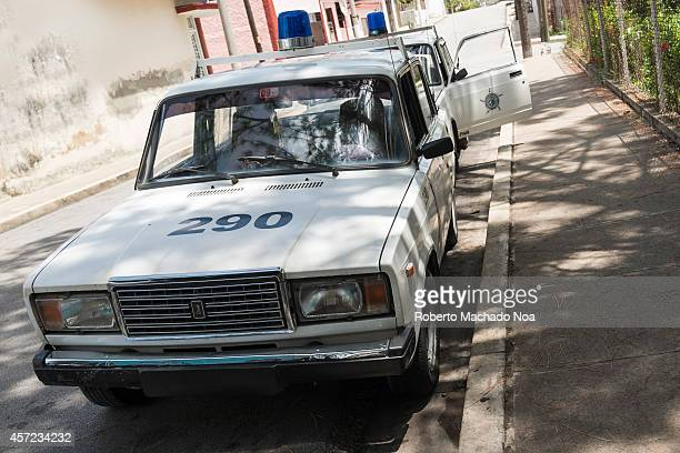 Cuban Revolutionary Police cars parked in front of a station The PNR is known among Cubans as a inflexible repressive orngan of the state plaged with...