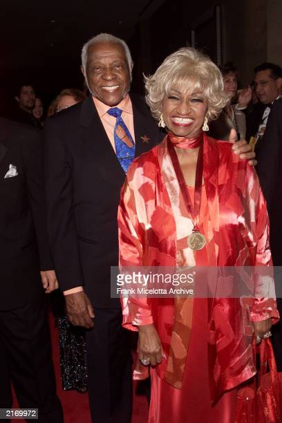 Cuban salsa singer Celia Cruz and her husband Pedro Knight arrive at the 2001 Latin Recording Academy Person of the Year Tribute to Julio Iglesias at...