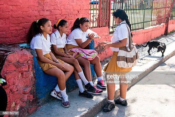Cuban schoolgirls on a bench Havana Cuba