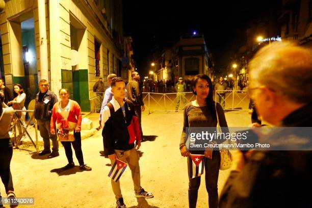 Cuban security personnel observe a march as Cuba celebrates the 165 anniversary of the birth of its national hero Jose Marti on January 27 in Havana...