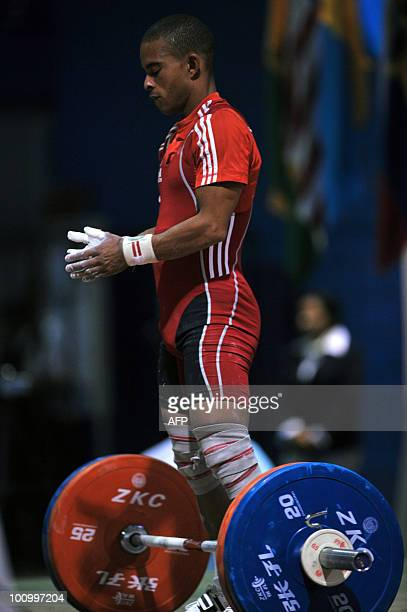 Cuban Sergio Alvarez prepares to lift to win the gold medal in the 56 kg competition during the XXI PanAmerican Championship in Guatemala City on May...